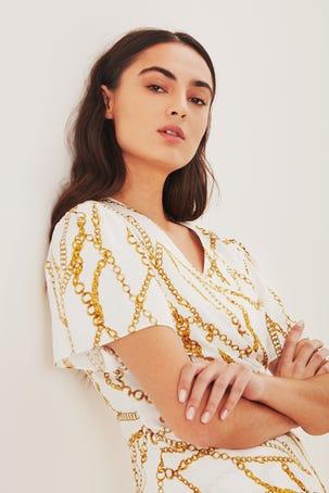 Blusa Blanca Con Cadena